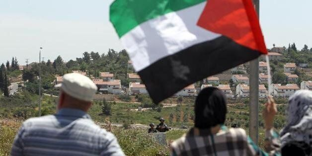 Manifestants palestiniens contre l'expansion d'une colonie juive à Nabi Saleh, en Cisjordanie, durant...