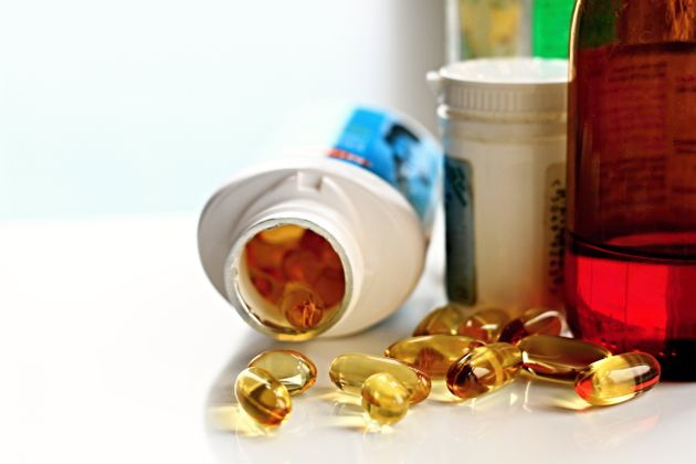cod liver oil pills on green table no people stock
