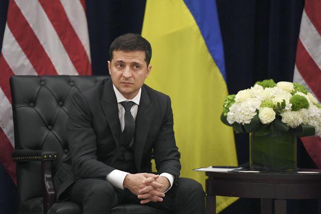 US President Donald Trump(not shown) speaks as Ukrainian President Volodymyr Zelensky looks on during...