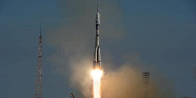 La torche olympique dans l'espace pour la première fois de son