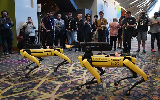 Robotic dogs called Spot, built by Boston Dynamics, are demonstrated at the Amazon Re:MARS conference...