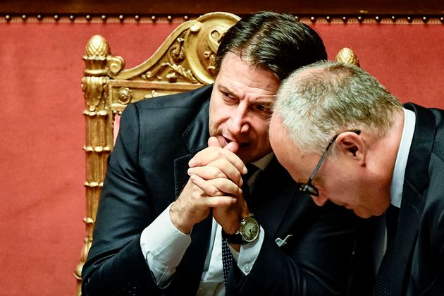 Italy's Prime Minister Giuseppe Conte (L) and Italy's Finance and Economy Minister Roberto Gualtieri...