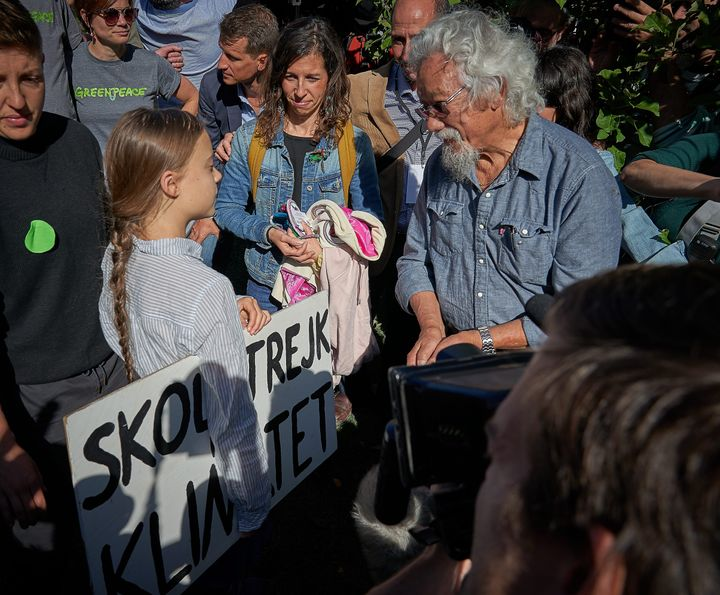 Swedish climate activist Greta Thunberg chats with Canadian environmental activist David Suzuki in Montreal on Sept. 27, 2019.  Millions of people across the world are taking part in demonstrations demanding action on climate issues.