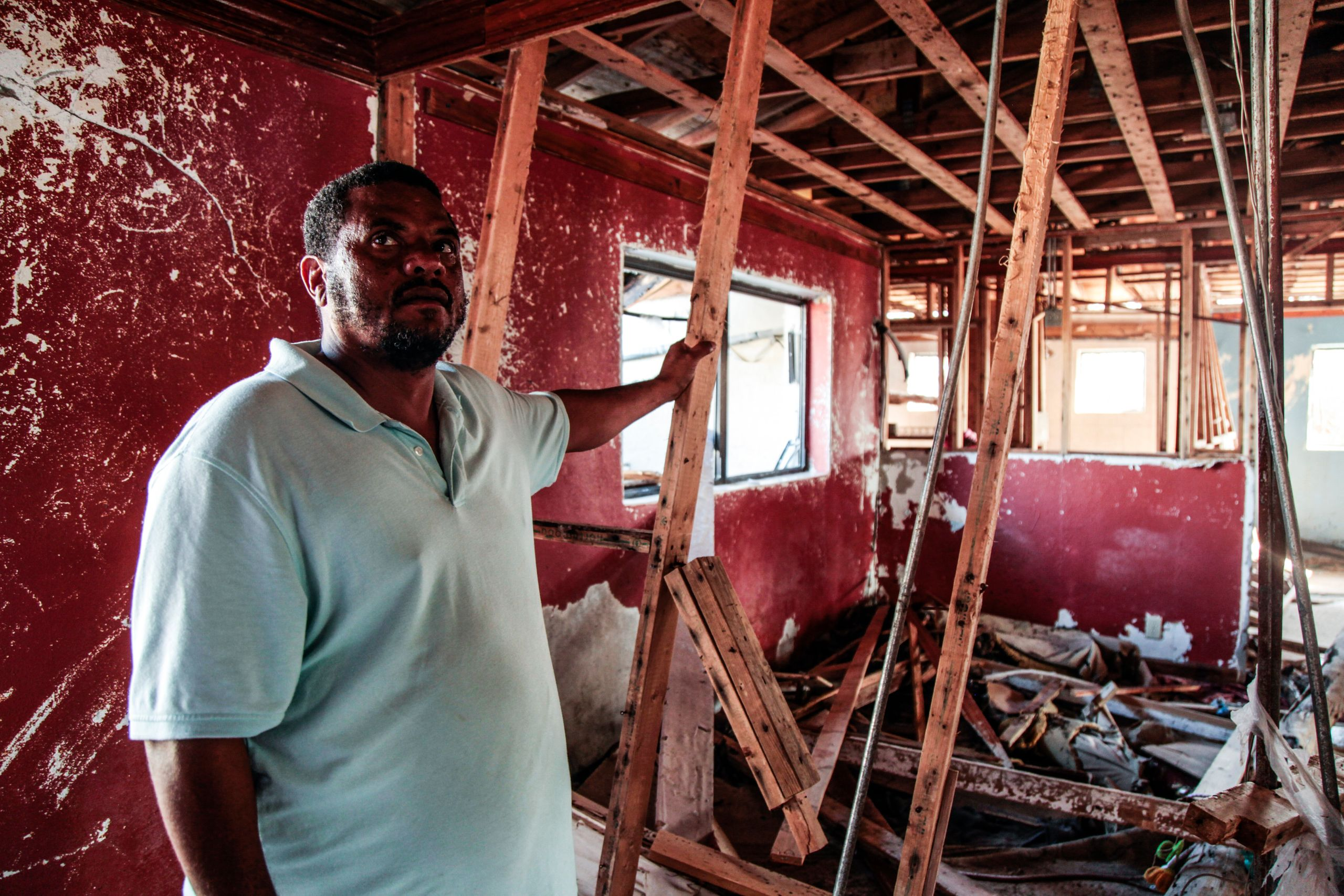 Pastor Raymond Simozne stands in his demolished home in Freeport, Grand Bahama on Sept. 24, 2019.