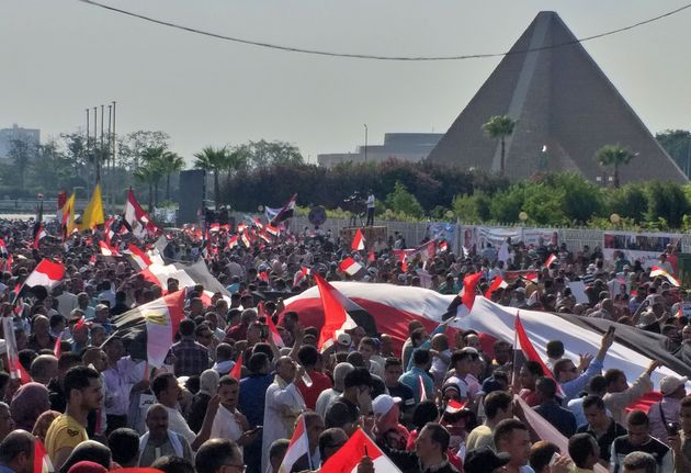 Supporters of Egyptian President Abdel Fattah al-Sisi rally near the Unknown Soldier Memorial in the...