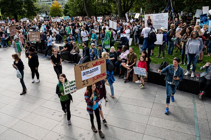 """The wrong Amazon is burning,"" reads a sign at a climate protest in Toronto on Sept. 27, 2019, in reference to forest fires that have burned through the Amazon rainforest in Brazil."