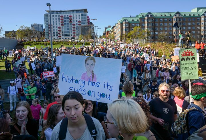 A drawing of Greta Thunberg is seen on a protest sign as thousands march on the property of Nova Scotia Power during a climate strike in Halifax on Sept. 27, 2019.