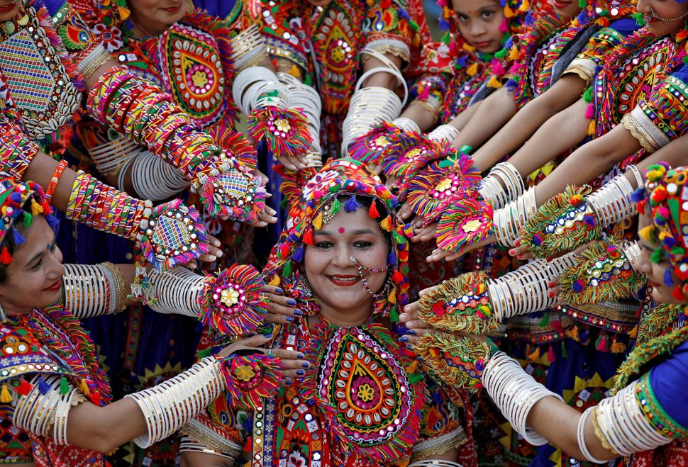 Participants dressed in traditional attire pose at rehearsals for Garba, a folk dance, in preparations...