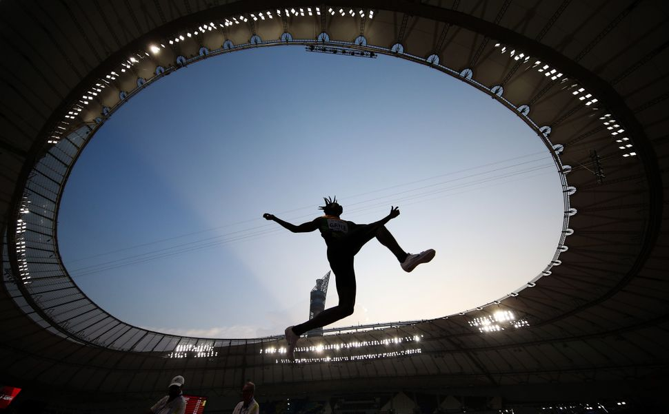 DOHA, QATAR - SEPTEMBER 27: Tajay Gayle of Jamaica competes in the Men's Long Jump qualification during...
