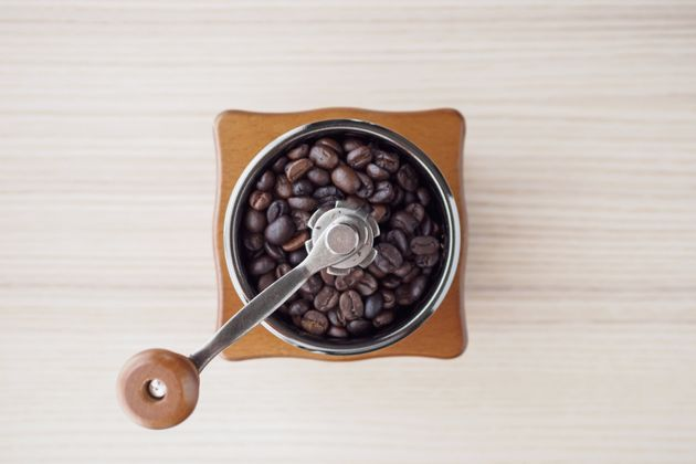 A burr grinder uses two revolving surfaces to basically crush beans a few at a