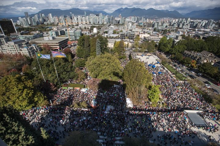 Thousands of people gather outside Vancouver City Hall before marching downtown for a climate strike in Vancouver on Sept. 27, 2019.