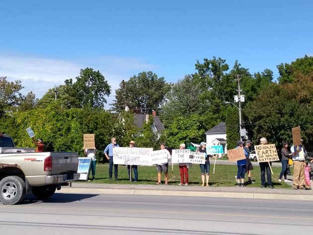 Demonstrators take to Main Street in Picton, Ont. to demand action on climate change on Sept. 27,