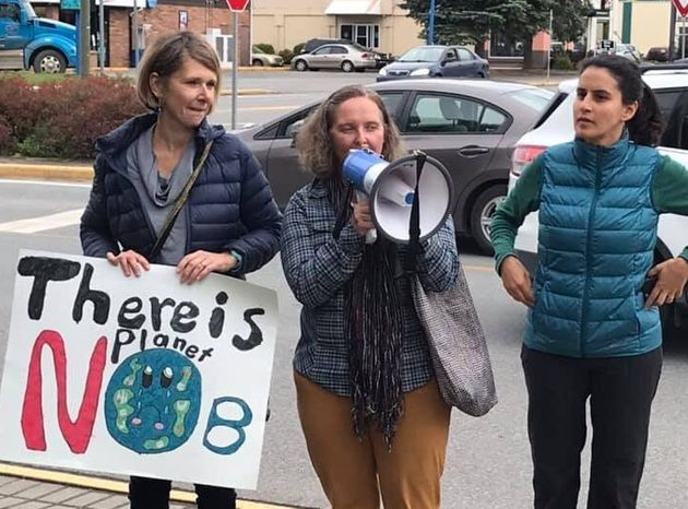 Three people protest to demand action on climate change in Terrace, B.C. on Sept. 20,