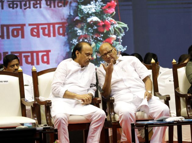 PUNE, INDIA - OCTOBER 29: NCP leader Ajit Pawar (L), and NCP President Sharad Pawar and Foziya Khan during...