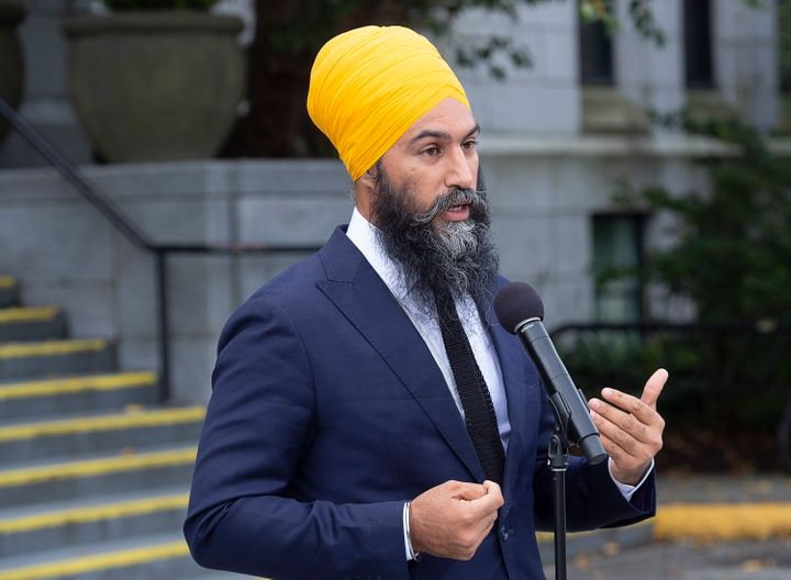 NDP Leader Jagmeet Singh fields questions from reporters after a campaign stop with Mayor Kennedy Stewart at city hall in Vancouver on Wednesday, Sept. 25, 2019.  (Andrew Vaughan/The Canadian Press via AP)