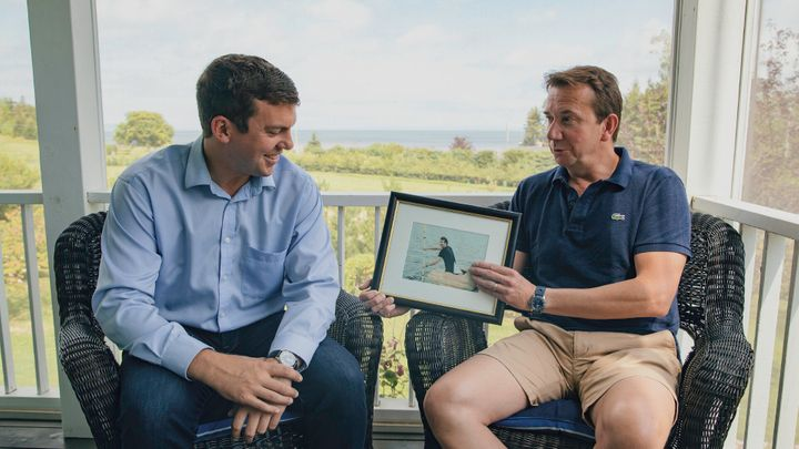 Liberal candidate Kody Blois and Scott Brison chat at the former Liberal cabinet minister's Cheverie, N.S. home talk about a local pumpkin paddling tradition and to impart advice on keeping a level head in federal politics.
