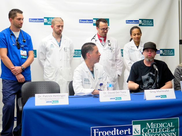 Greg Manteufel sits surrounded by the medical staff at Froedtert & the Medical College of Wisconsin...