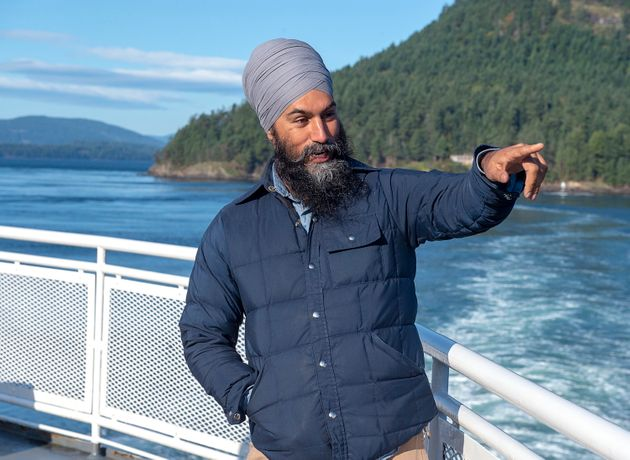 NDP Leader Jagmeet Singh takes in the sights after a media availability as he takes a ferry from Victoria...