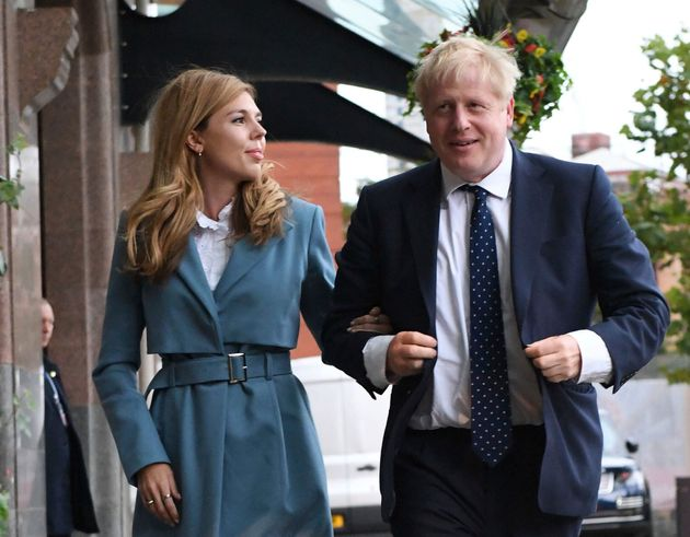Prime Minister Boris Johnson arrives at the Conservative Party conference in Manchester accompanied by...