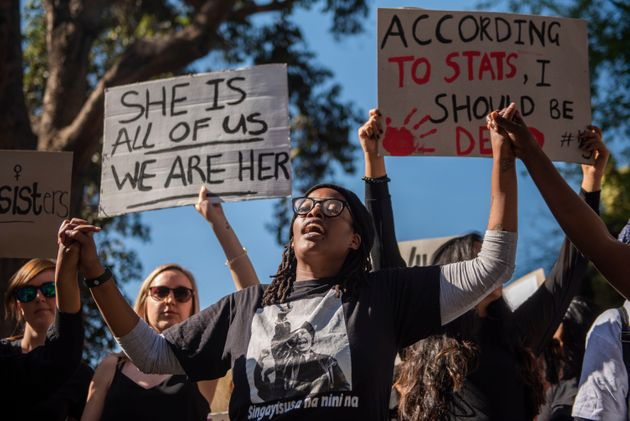 Protesters march against gender-based violence in Sandton, South Africa on Sept.