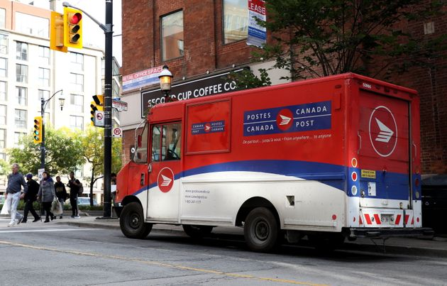 A Canada Post truck is seen illegally parked in downtown Toronto on