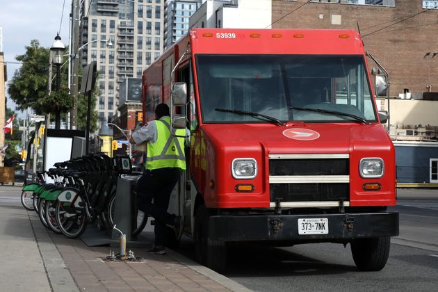 A Canada Post carrier leaves his truck in downtown Toronto on