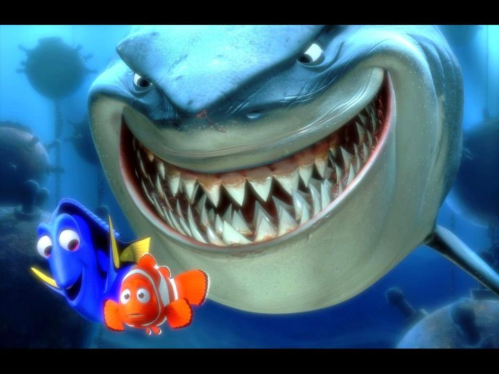"Marlin and Dory with Bruce the shark in scene from movie ""Finding Nemo."""