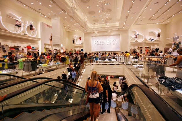 Customers shop at the Forever 21 flagship store in New York's Times Square on June 25,
