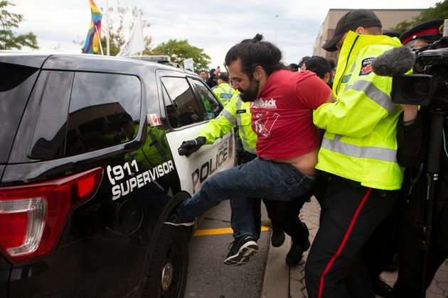 A protester is arrested before People's Party Leader Maxime Bernier holds an event in Hamilton, Ont.,...
