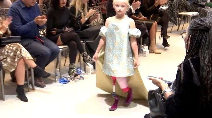 Model Daisy-May Demetre, a nine-year-old double amputee, walked the runway during Paris Fashion Week for luxury children's wear label Lulu et Gigi.