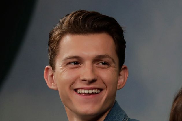 Actor Tom Holland smiles during a press conference for his new movie