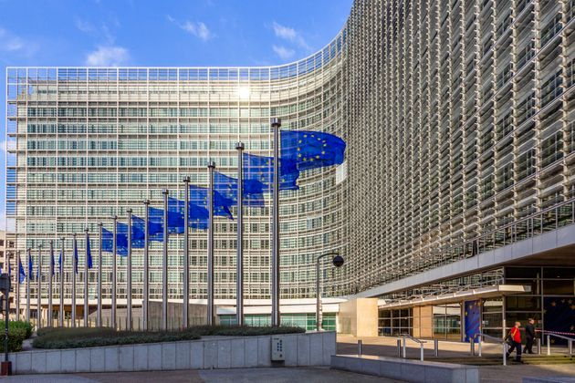 Brussels, Belgium - July 30, 2014: Row of EU Flags in front of the European Union Commission building...