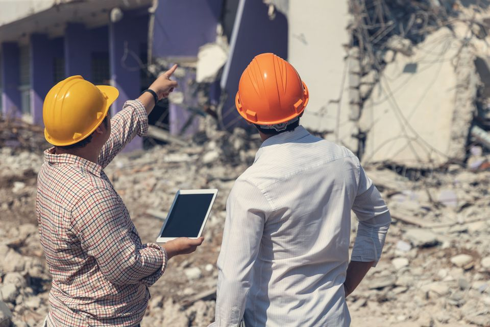 Engineer architect and worker operation control demolish old