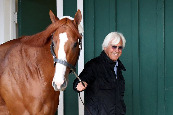 Trainer Bob Baffert walks Kentucky Derby winner Justify in the barn ahead of last year's Preakness Stakes in Baltimore.