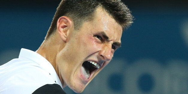 BRISBANE, AUSTRALIA - JANUARY 06: Bernard Tomic of Australia celebrates a point in his match against Radek Stepanek of the Czech Republic during day four of the 2016 Brisbane International at Pat Rafter Arena on January 6, 2016 in Brisbane, Australia. (Photo by Chris Hyde/Getty Images)