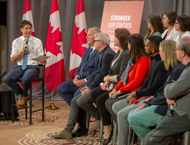 Liberal Leader Justin Trudeau speaks with trauma care workers during a discussion on gun violence gun...