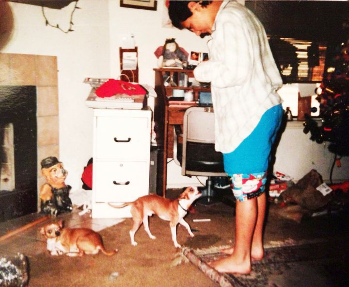 Me standing in our putrid living room with some of our chihuahuas. I loved them so much despite their waste that littered the