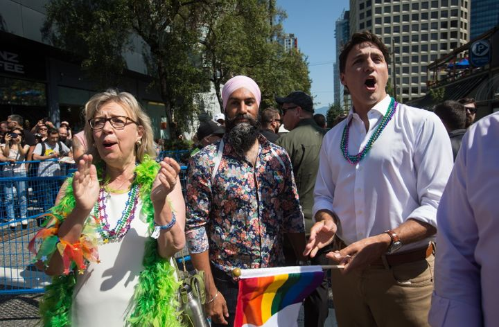 Liberal Leader Justin Trudeau, right, cheers while waiting to march in the Vancouver Pride Parade with Green Party Leader Elizabeth May, left, and NDP Leader Jagmeet Singh, centre, in Vancouver, on Sunday August 4, 2019.