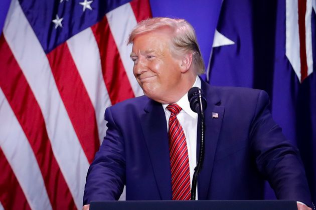 President Donald Trump smiles alongside Australian Prime Minister Scott Morrison as they mark the opening...