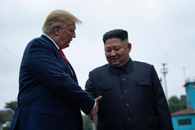 US President Donald Trump and North Korea's leader Kim Jong-un shake hands before a meeting in the Demilitarized...