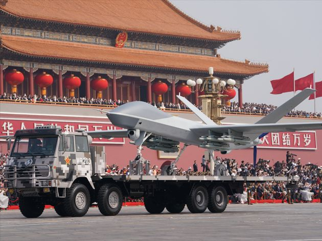China's self-made weapons, vehicles and planes are shown during the military parade of the celebration...