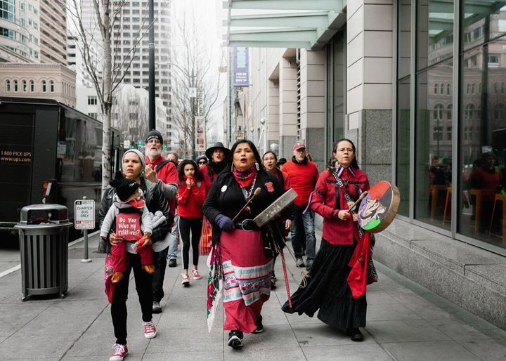 Rachel Heaton (front left) campaigning against Chase Bank in April 2019 for its funding of fossil fuel projects and the impacts on indigenous communities.