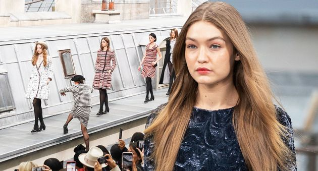 Gigi Hadid looked unimpressed as she removed a catwalk crasher at the Chanel Show. [Photo: