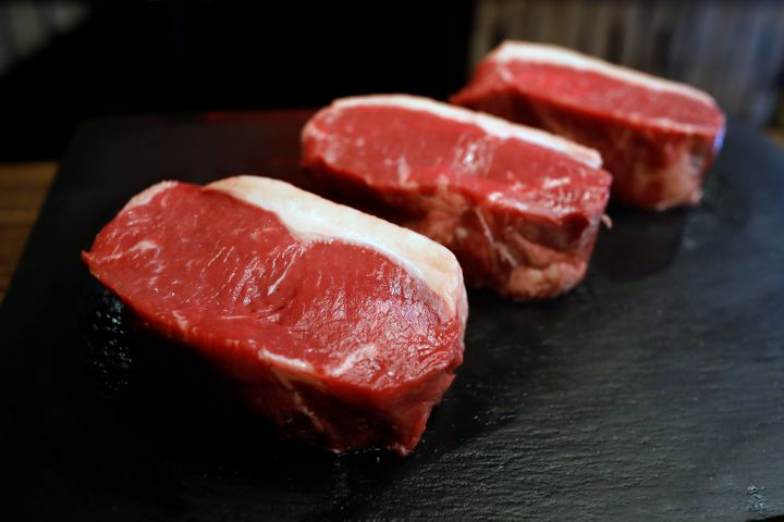 Strip steaks are seen at a restaurant in Madrid on July 27, 2017.
