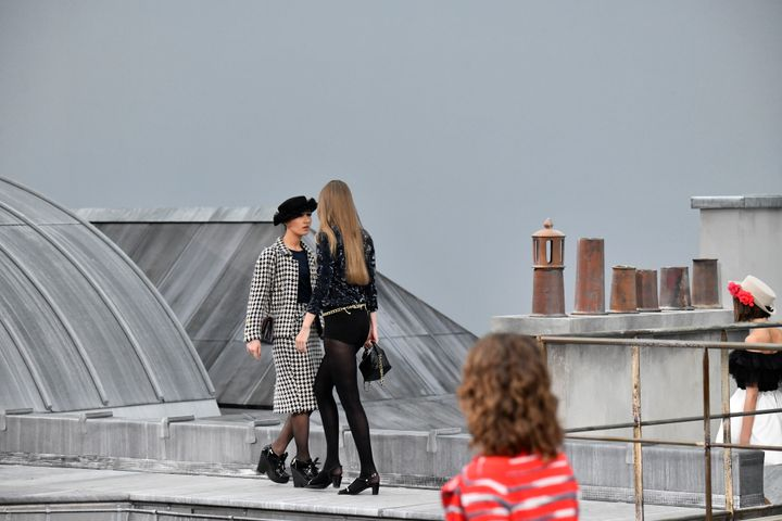The woman appears to try to walk past Hadid.