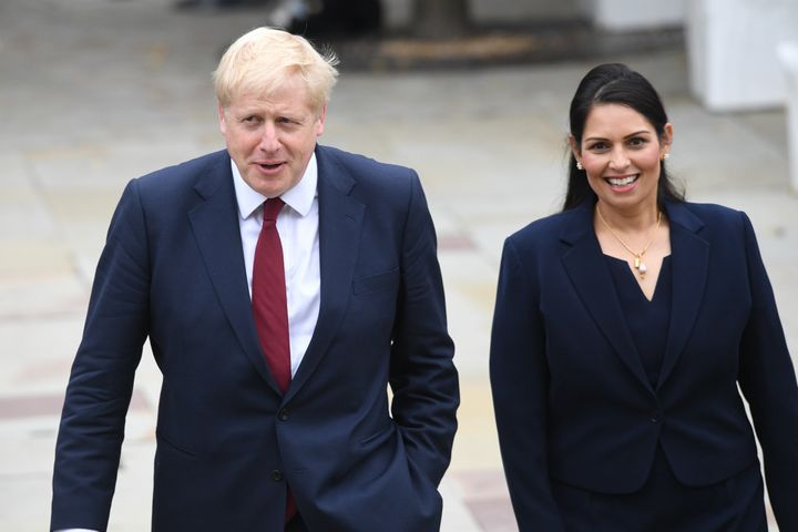 Prime Minister Boris Jonhson walks with Home Secretary Priti Patel at the Conservative Party Conference at the Manchester Convention Centre.