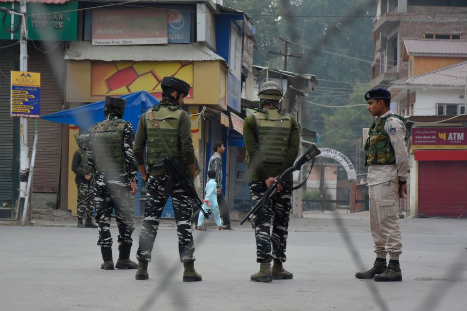 Indian forces stand alert during restrictions in Srinagar, Jammu and Kashmir on 27 September