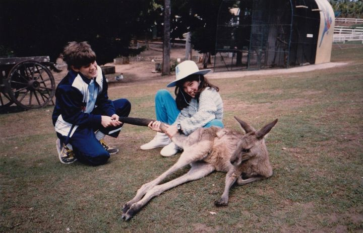 Varnish (right) and her brother Daniel pretending to pull a kangaroo's tail at Brisbane's Lone Pine Sanctuary, Australia duri