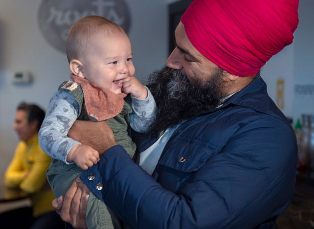 NDP Leader Jagmeet Singh holds seven-month-old Alder Tull-Best at a campaign stop in Vancouver on Oct....