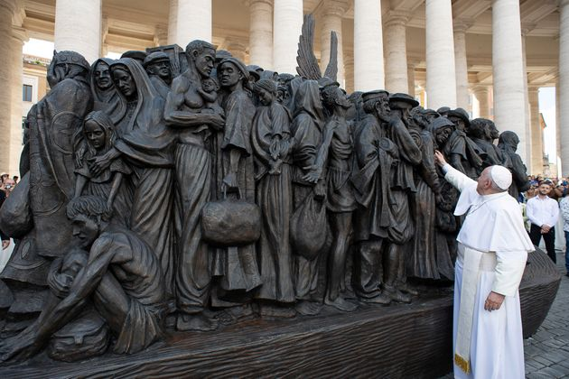 Pope Francis attends the unveiling Sunday of the sculpture commemorating migrants and refugees by Canadian...